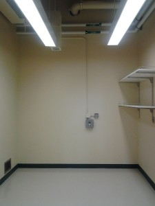 This room will house the TEM. Low vibrations, low magnetic fluctuations, low acoustical noise (1-600 Hz). Power will be connected to the breakout box, which can be shut off both at the wall and at the electrical panel. Vacuum, cooling water, and compressed air hoses will go through the pass-through near the floor to 171A. The fluorescent lights are dimmable, for those times when we're looking for a dim beam but still need to see the instrument panel.